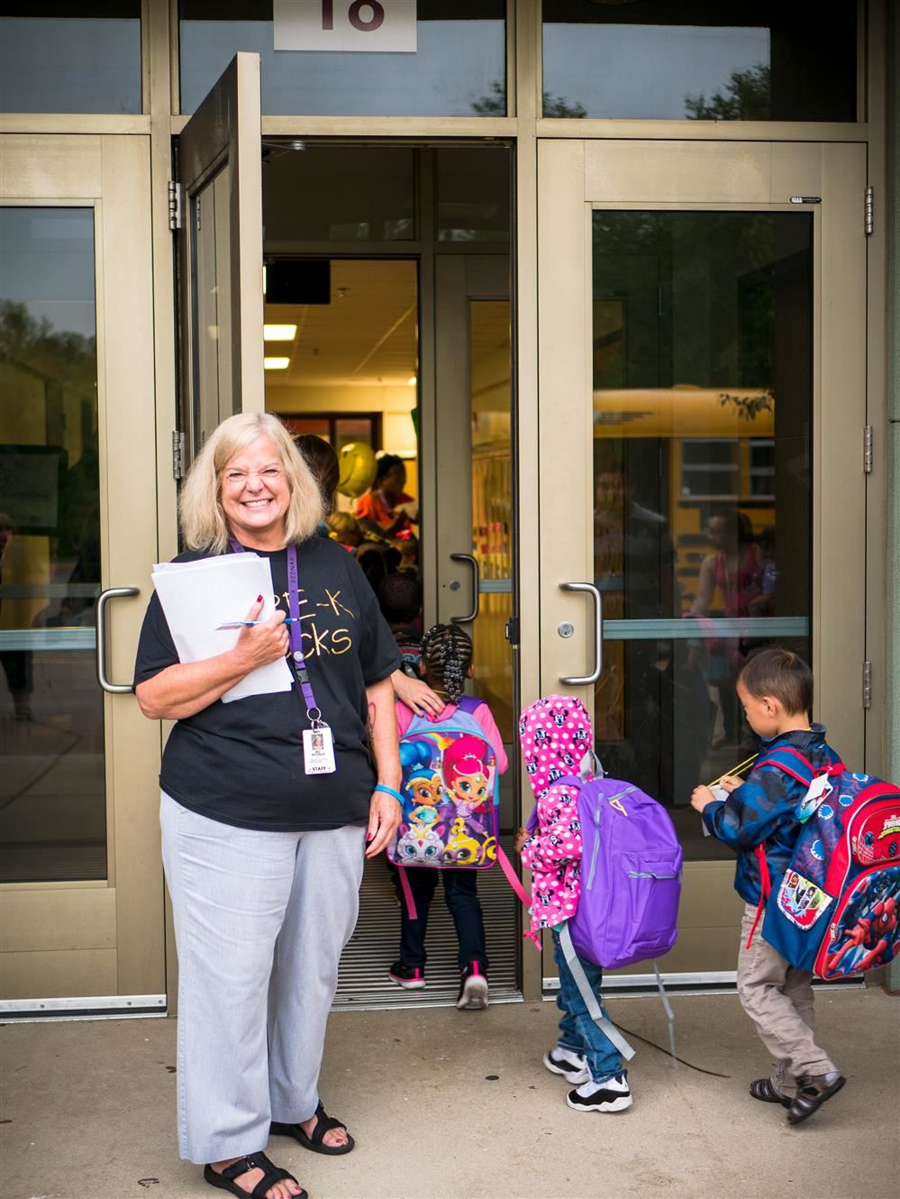 Early Learning secretary Amy Bednar welcomes students on the first day of school