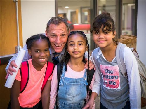 Randy Koch with students on the first day of school