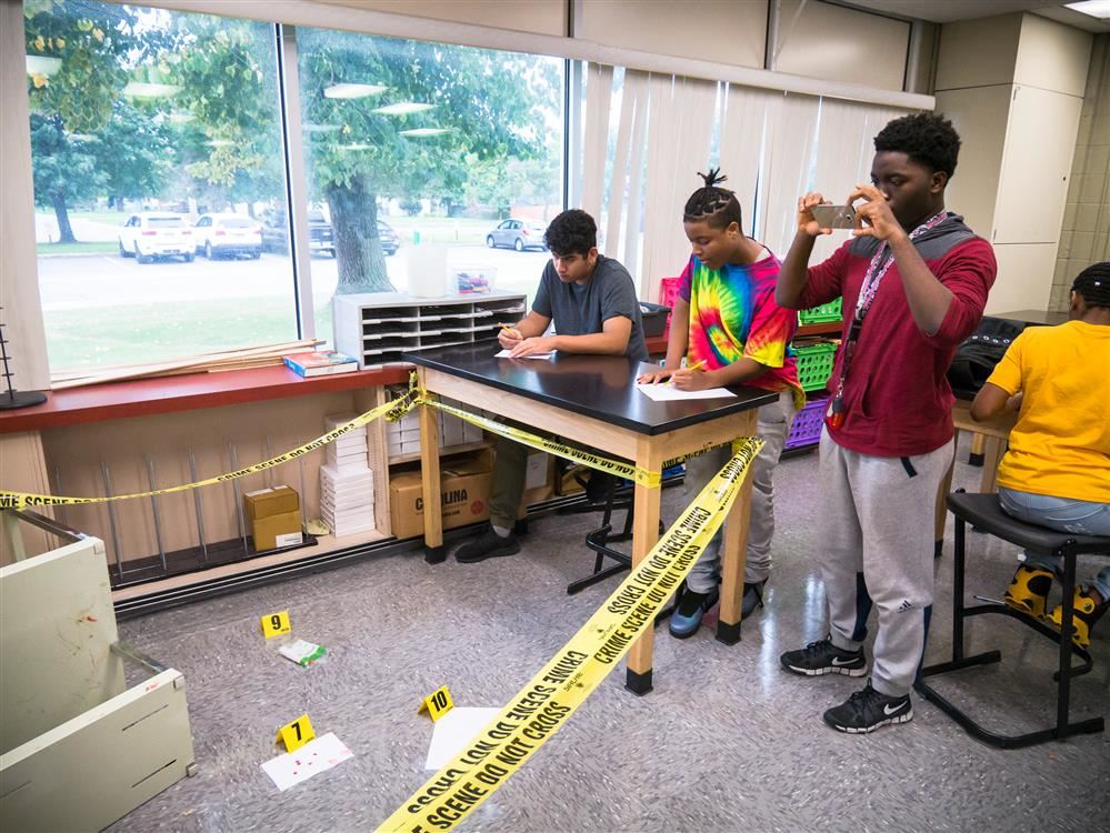 High school students investigate a crime scene